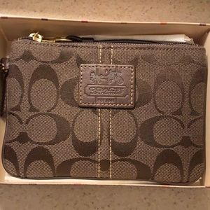 NWOT coach wristlet wrapped with box and ribbon